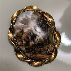 Vintage gold scenery pin.